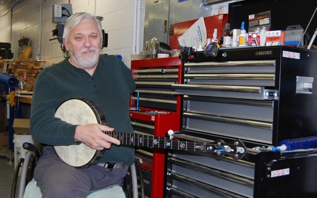 Banjo maker Bill Rickard in his Aurora workshop at General Conveyors.