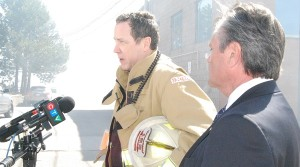 CYFS Deputy Fire Chief Paul Leslie, accompanied by Newmarket-Aurora MPP Frank Klees, update the media amid the smoke just after 3 p.m.