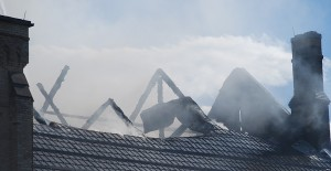 The heavy beams which characterized the inside of the church were reduced to cinders as fire gutted the historic landmark.