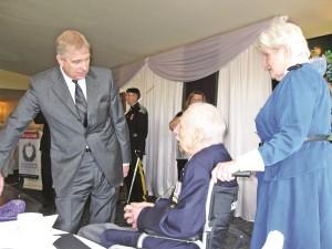 The Duke of York meets Aurora veterans John Wilkes and Dorothy Gummersall at Thursday's fundraising lunch.