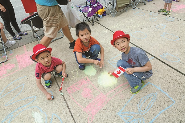 Before Saturday morning's traditional Canada Day parade, kids were invited to leave their mark outside the Aurora Public Library with chalk drawings wishing Canada a Happy Birthday.