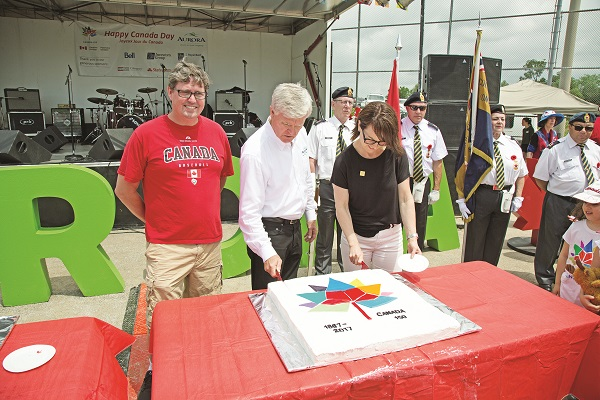 Following the Parade, festivities shifted to Lambert Willson Park for a full day of fun and an evening of music and fireworks. Here, MP Kyle Peterson, Aurora Mayor Geoff Dawe, and Ulrika Liljeberg, Mayor of Leksand, Sweden, Aurora's Twin Town, cut the Sesquicentennial cake.